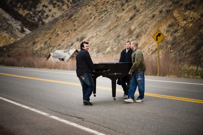 Kevin, his manager and one of the models carying a Grand Slam baby grand body across the highway back to the tour bus after the photo shoot.
