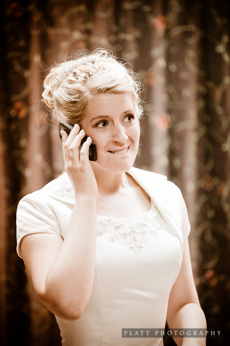 The Bride taking a phone call before her reception
