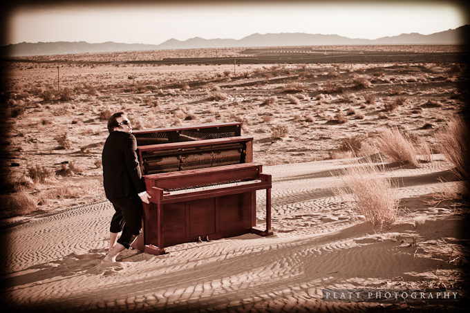Kevin Burdick and his Red Piano on a small Sand Dune
