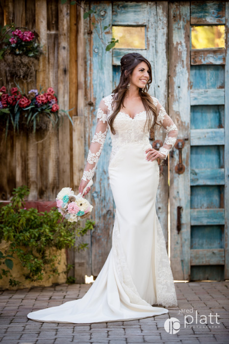 The bride wearing a Tara Keely wedding dress by Lazaro with added lace sleeves.