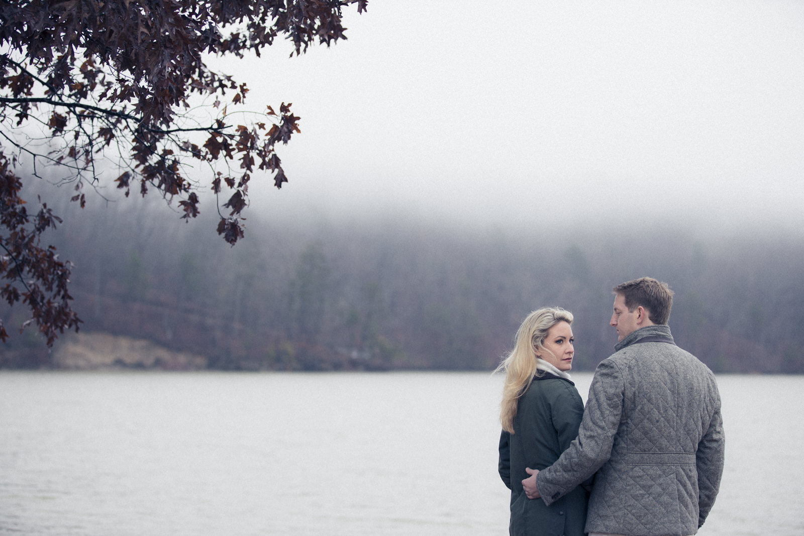 Engagement portraits in Atlanta Georgia near the lake fog rolling in